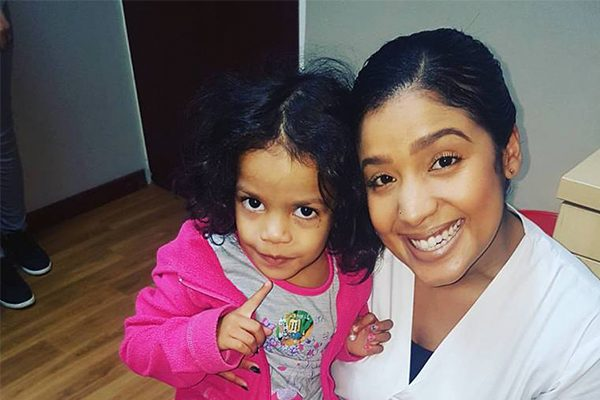 Dr Nichole Hendricks with young child, Dentico